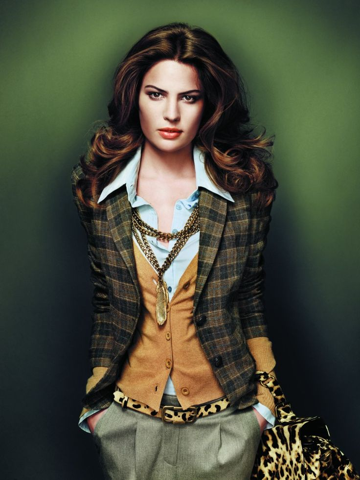 Model in plaid equestrian jacket with elbow patches,