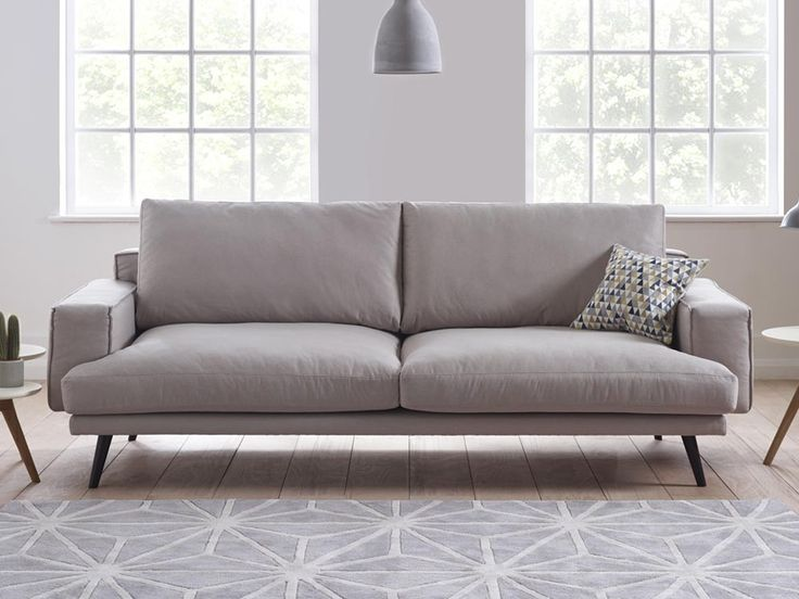 Theo Sofa - With its wide shape and funky armrests, Theo is an unapologetically retro sofa that is brought up to date with a strong composite frame and precise hand finishing - by www.livingitup.co.uk