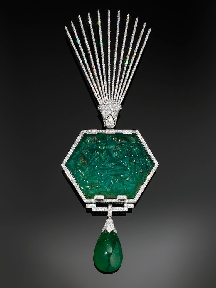 A platinum and diamond aigrette designed by Cartier in 2012 uses a historical emerald carved in India and depicts a scene from the Hindu epic the Ramayana.