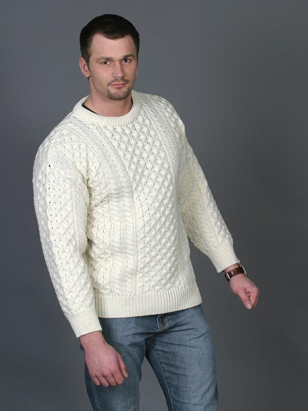 Special Offer. Crew neck Aran sweater in 100% soft merino wool. Suitable for men and women. It has all the Traditional Irish Aran patterns. The honeycomb pattern fills the central panel, symbolic of the hard working bee or the toil of a fisherman. On either side of the large panel there are rows of cable stitches resembling the fishermans ropes.