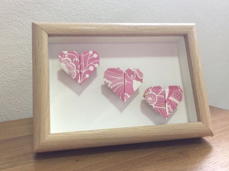 A personal favourite from my Etsy shop https://www.etsy.com/au/listing/516332093/framed-hearts-heart-origami-three-hearts