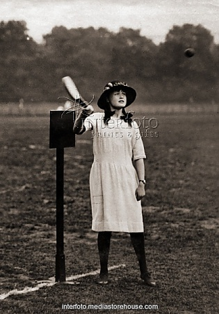 Young woman playing rounders, 1920s  sports, stoolball, young woman during a match at Battersea Park, London, between the Council Committee and the Council Staff Team, England, circa 1920s,.