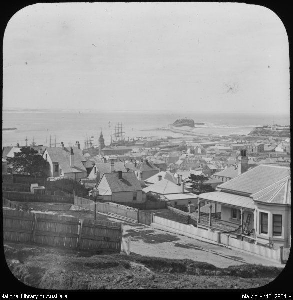 King, Henry, 1855-1923. View across town towards Nobbies breakwater, Newcastle, New South Wales, ca. 1887 [transparency]
