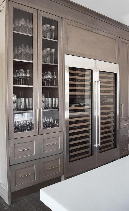 Love the gray washed cabinets, and glassware storage. Side By Side Wine Coolers. Stunning kitchen design from H Ryan Studio