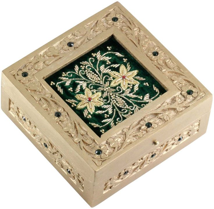 Rarely you would find the fusion of 2 great traditional arts of India in 1 piece! This jewelry box is certainly one of those!! Hand-carved in wood and adorned with golden beads in intricate design, this piece-of-art is definitely not to be missed. Limited in stock, this treasure box is something not to be missed!!