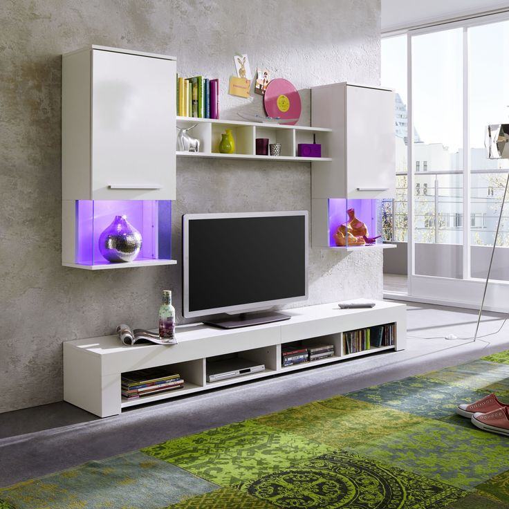 diese stylische wohnwand mit hochglanz fronten besteht aus zwei hngevitrinen xl lowboard und wandregal - Stylische Wohnwand