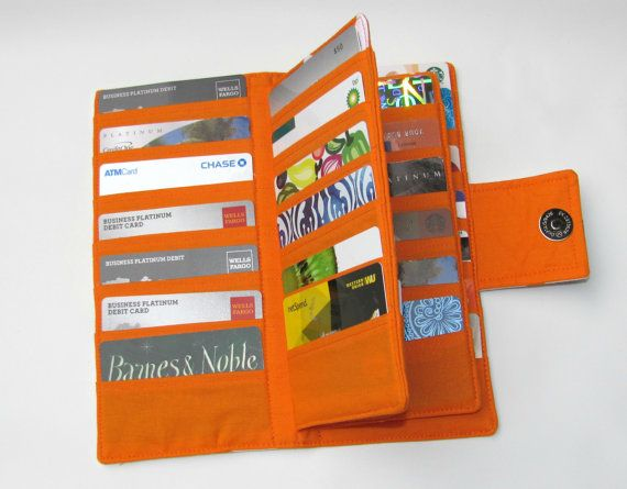 This card organizer is the perfect accessory! it has 38 slots is perfect to accommodate all your credit cards, gift cards, membership cards other kind of cards. Would make a nice present with a gift card inside!  Specifications Size - 8 x 8 opened Size - 8 x 4 closed Magnetic Snap closure Holds 38 cards 100% cotton material  ~~~~~~~~ This item is IN STOCK and READY to SHIP ~~~~~~~~~~~~~~~  Comes from a smoke-free, pet-free environment.I select only the best fabrics around and I guaranteed…