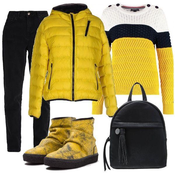 All'insegna del giallo e nero questo look è adatto per il tempo libero. I jeans baggy neri sono indossati con una maglia di Tommy Hilfiger e con degli stivaletti originali e graziosi. Sopra a tutto un bomber, giallo profilato in nero e un pratico zainetto. Anche grazie ai jeans baggy, questo look è adattissimo a tutte le taglie.