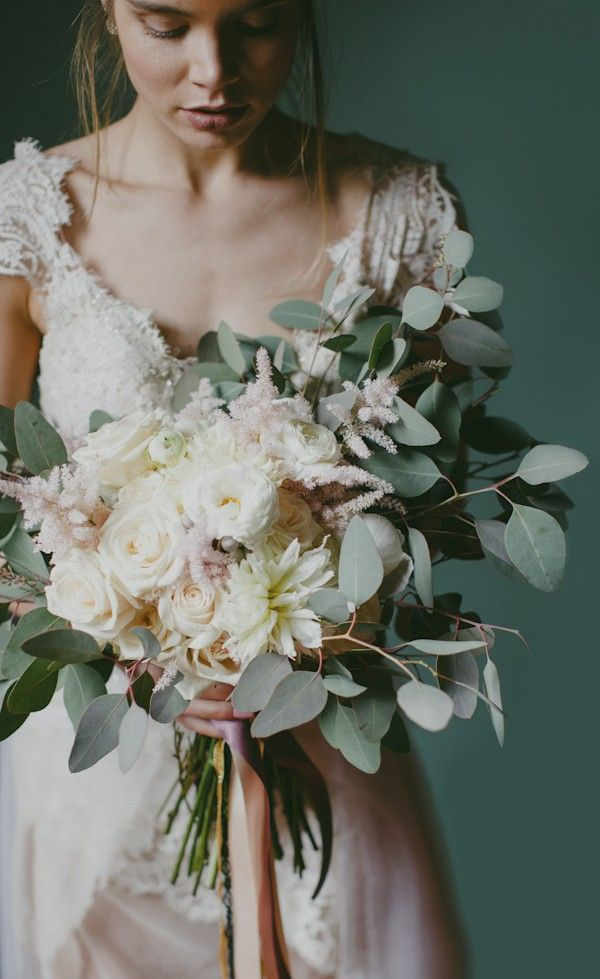 Romantic ivory, blush, and green spring bridal bouquet