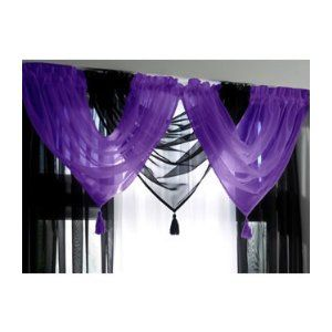 I love the idea of layering another sheer colored curtain over the black!