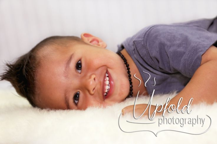 Gorgeous little boy, relaxed and having fun. Image by Upfold Photography, Auckland.