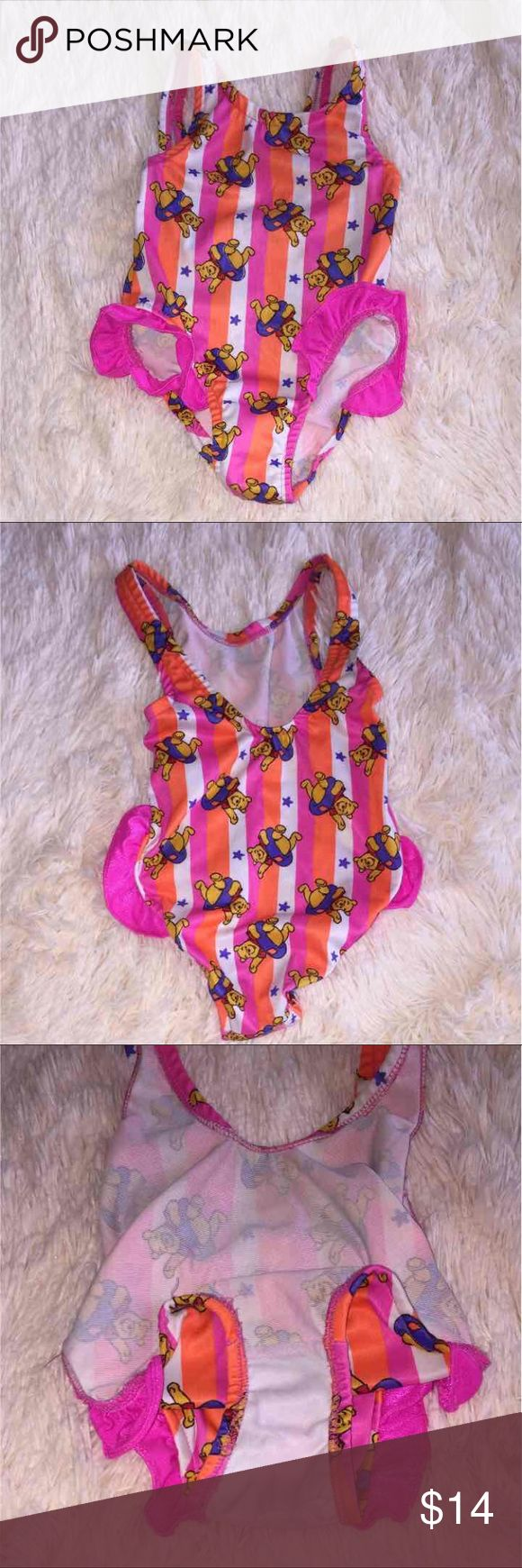 Winnie the Pooh Baby Girl Swim Suit 24MOS Disney Winnie the Pooh Size: 24 MOS No stains or holes Great condition  Little ruffles around the leg opening, lower in the back than the front  Orange, pink, white, and Winnie! :) Disney Swim One Piece