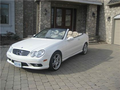 Mercedes Benz CLK 500 Convertible. The same exact one I test drove. Hubby thinks the white one suits me. ☺