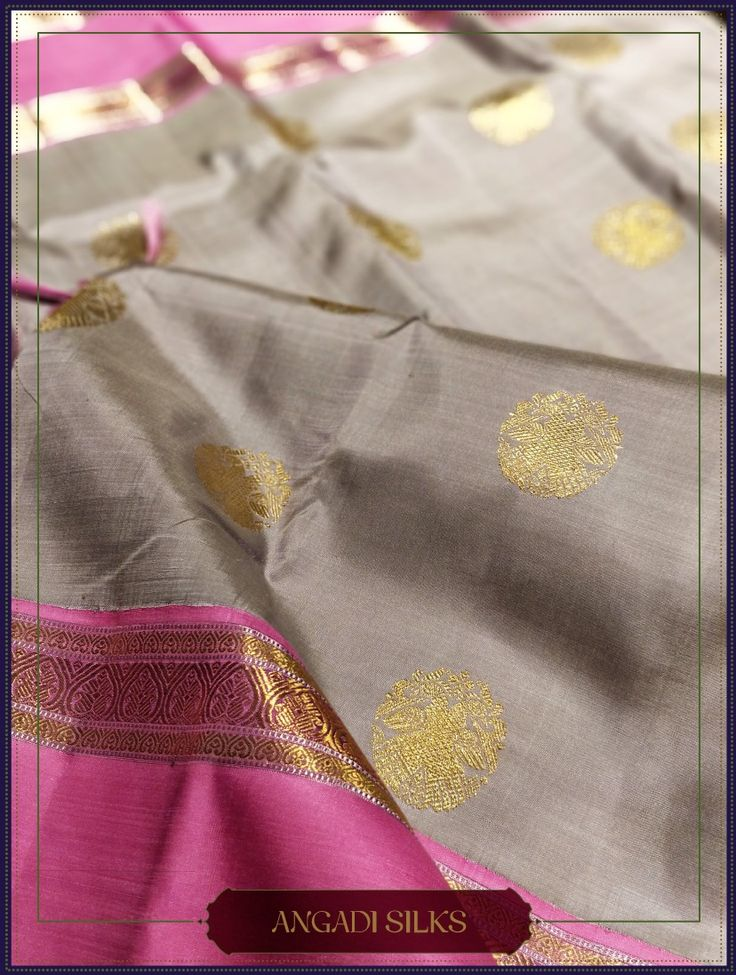 "This Kanjivaram Saree personifies Elegance and Art. Carefully crafted ""Gandaperunda"" - The Heritage Motif symbolizing royalty and power enhances the grace of the saree. The unique color combination of the grey and bright pink utter sophistication. Style them Precious Stone Jewelry. #AngadiSilks #Angadi #TheHouseOfAngadi #Silks #SilkSari"