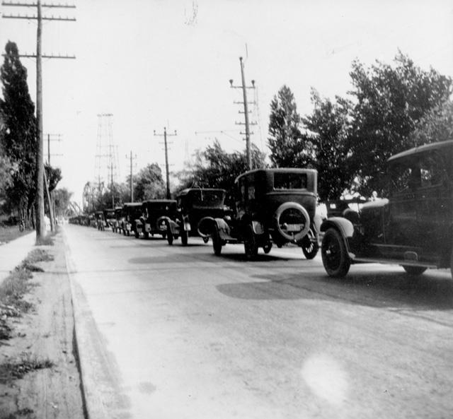 A line of automobiles heading towards the Beach Strip.