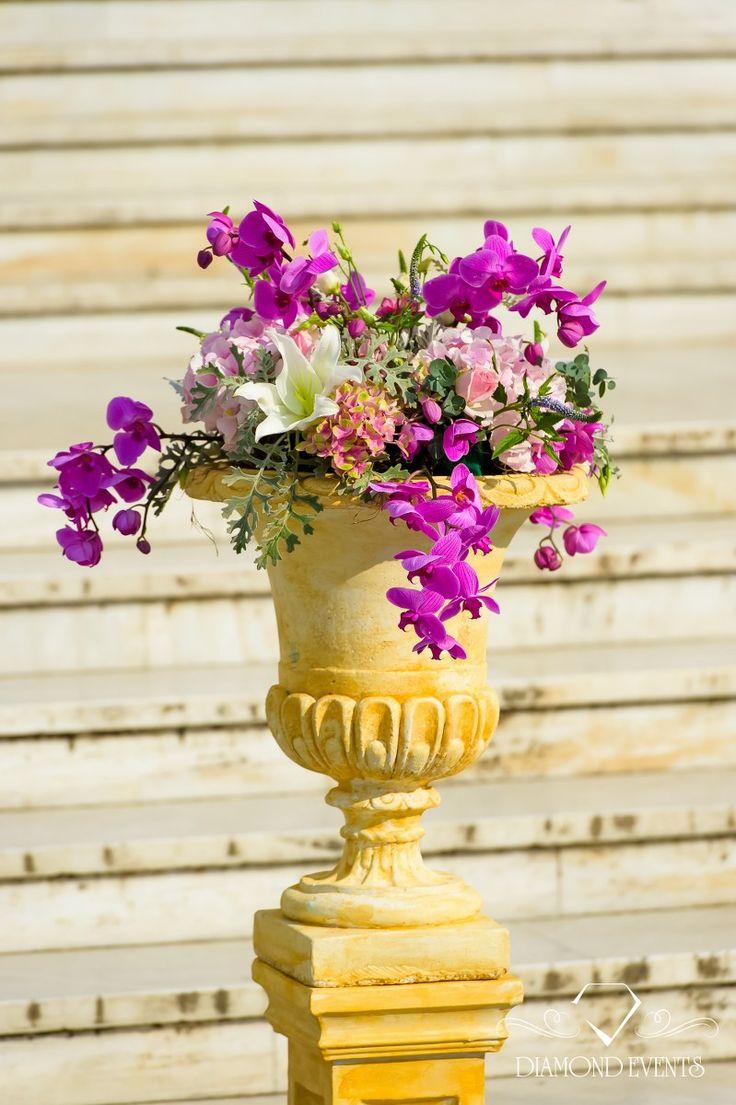 Gold pillars with purple orchids for a chic and unique ceremony decoration! For more visit: diamondevents.gr  You can also find us on: https://instagram.com/diamond_event_planners/ https://www.facebook.com/pages/Diamond-Event-Planners/176242063682 https://www.pinterest.com/diamondwedding/  #celebrity #centerpiece #chic #christmas #crystal #decor #decoration #design #destinationwedding #diamondevents #dubai #ekali #elegant #event #fabrics #fabulous