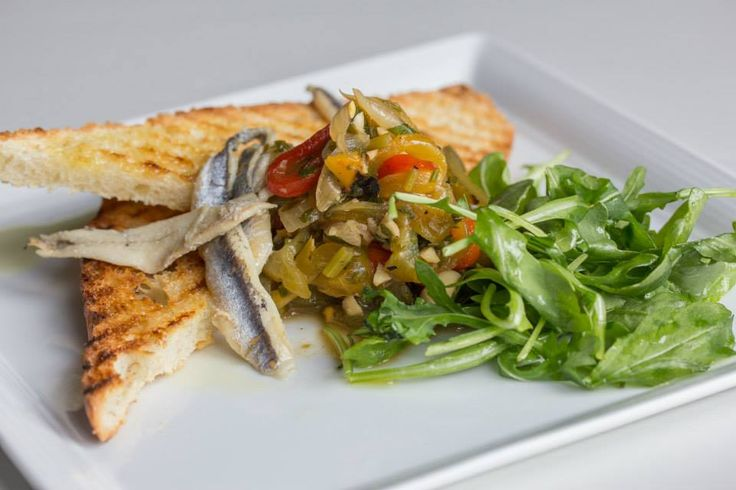 Bruschetta with peperonata, arugula, white anchovy & garlic crostini #Oakville #Restaurant #Food #Italian #Cucina