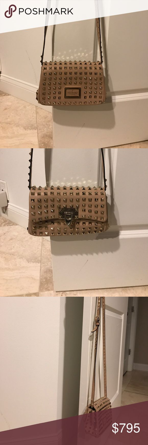 Valentino Rockstud cross body clutch bag. Nude I've owned this for a few years. Normal wear with some scratches.  Good condition. No missing studs or tears in leather. Valentino Bags Crossbody Bags