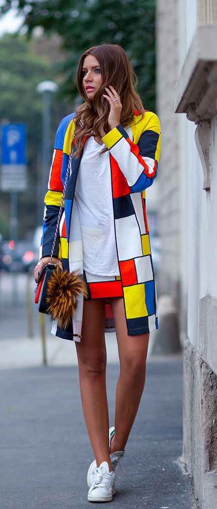 Veronica Ferraro is wearing a colour block jacket and skirt
