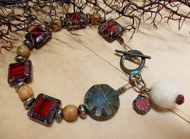 Autumn bracelet...olive wood beads, picasso beads, felt ball & round green patina clasp <3