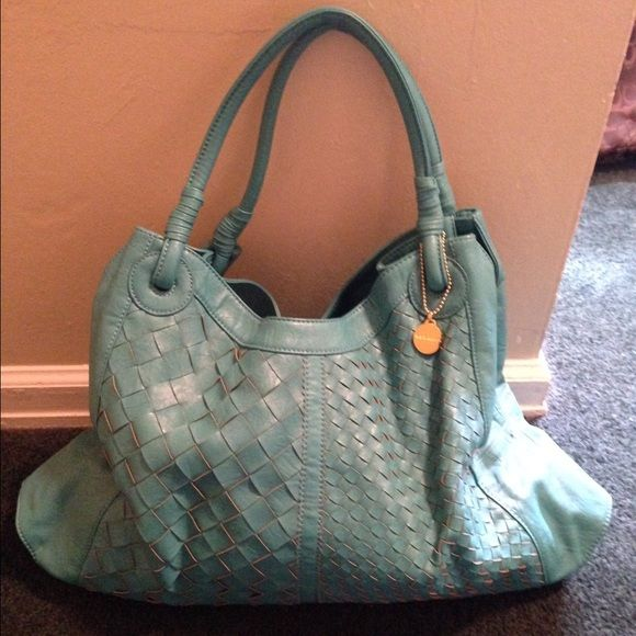 Big Buddha bag. Big Buddha handbag. Turquoise shoulder tote bag. Cloth interior with zipper compartment and cell phone slot. Used a couple of times. Big Buddha Bags Shoulder Bags