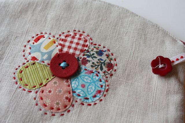 Fabric flower=cute using old fabric or clothing on maybe a handkerchief or apron.  Keepsake!