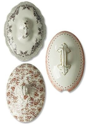 Bavarian tureen lids from Victorian Trading Co.  These can be hung on the wall in the kitchen, and used to hang dish towels.
