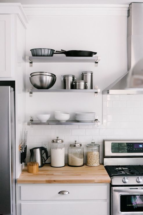 white kitchen with stainless steel fridge beside ikea ekby mossbyekby bjrnum wall shelves in