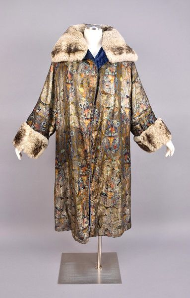 DECO PRINTED and LAME OPERA COAT with FUR TRIM, 1920s. Gold lamé with colorful Deco abstract design having self piping, wide fur collar and cuff, blue velvet lining, no closures. - whitakerauction