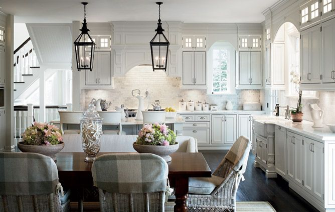 Lanterns over island in place of standard min pendants create an visual impact in this kitchen  - architectural digest