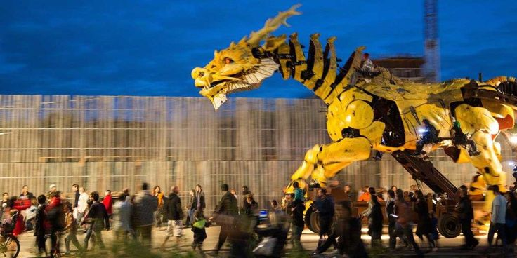 """La Machine unveiled their latest giant streampunk puppet—a fire-breathing, smoke snorting, walking dragon. The project is called Long Ma Jing Shen or """"The Spirit of the Horse Dragon."""" (see previous post for video)"""