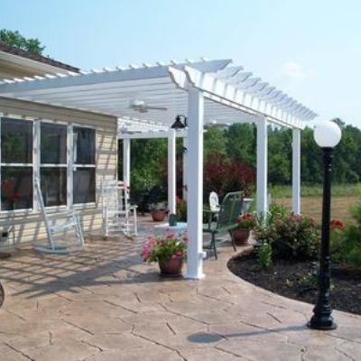 This pergola wraps around the corner of the house.  Was attached to the existing house and the existing stamped concrete patio.  Note the incorporation of ceiling fans and lights.