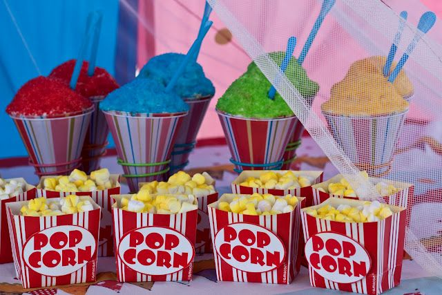 i made the popcorn cupcake sleeves out of cardboard popcorn boxes…and then attached a popcorn label to the front. the 'popcorn' is marshmallows {i cut an x into each marshmallow with kitchen sheers} sprayed lightly with yellow food coloring spray…