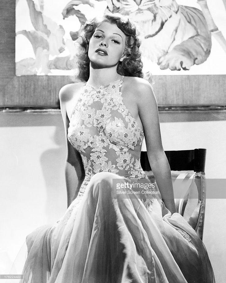American actress Rita Hayworth (1918 - 1987) in a halter-necked lace dress, circa 1940.