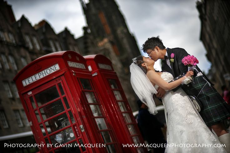 The Bride and The Groom share a special moment on Edinburgh's Royal Mile.