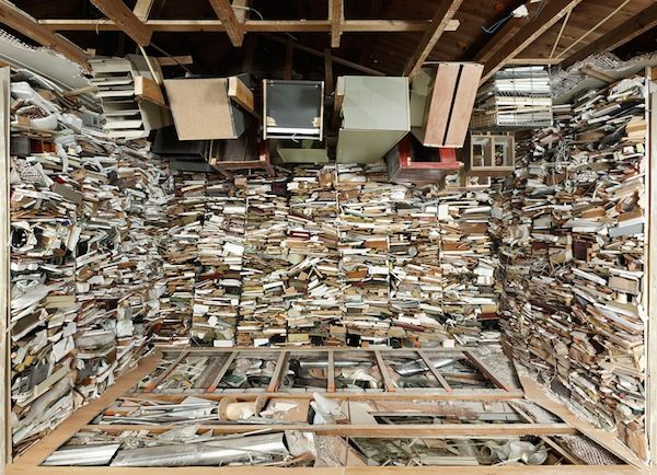 Dutch artist Marjan Teeuwen reclaims abandoned buildings by reassembling their contents — right down to the tiny pieces of plaster littering the floors and objects left behind by former residents. The obsessive project is visually stunning and completely suffocating to behold as the contents of each space are crammed together floor to ceiling.