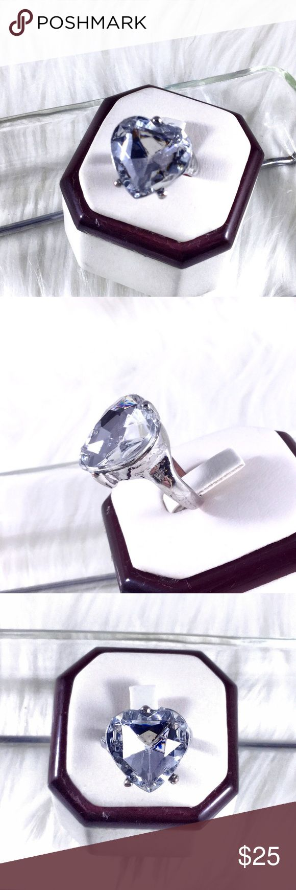 """Vintage Crystal Heart Cocktail Ring Sz 8. Large .75"""" diam  Clear heart shaped faceted Crystal Statement Ring  diamond cut. Mixed silver metal alloy. Back of ring has some discoloration. Art Deco retro bohemian boho glam. Comes with dust bag. Only 1 available. High end costume jewelry. Source is Estate vintage jewelry. 🌟 Save the most with bundles. I offer 25% OFF on bundles of 2+ items. I accept reasonable offers on single items & bundles. NO trades/holds/lowball offers. Boutique Jewelry…"""