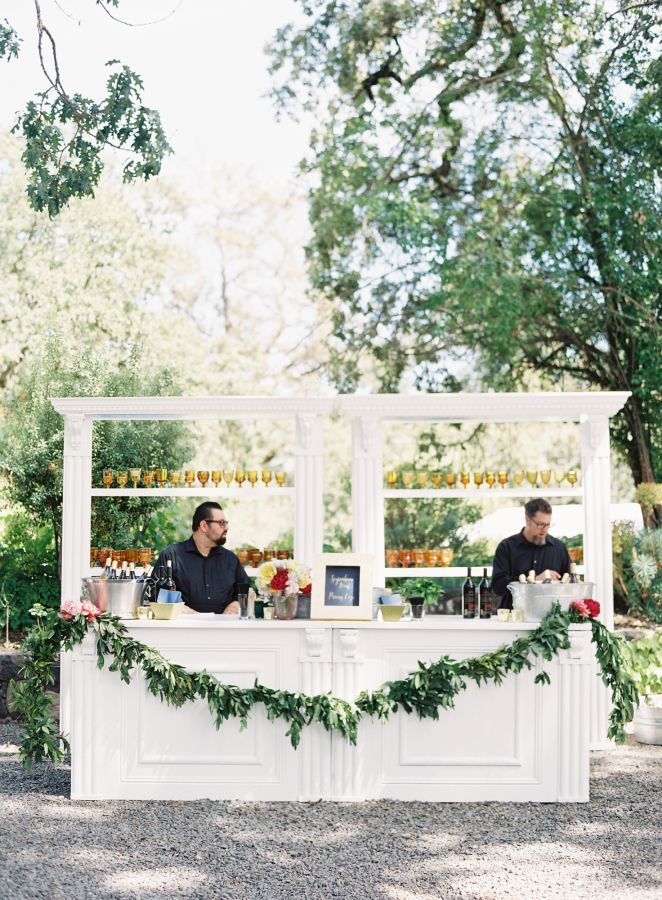 The perfect outdoor bar for a spring garden wedding: http://www.stylemepretty.com/2016/02/25/colorful-spring-garden-wedding-in-sonoma-valley/   Photography: Brett Heidebrecht - http://brettheidebrecht.com/