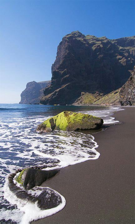 Playa de las Americas, Tenerife. Grown up adult holidays here! Fascinated by the black beach.