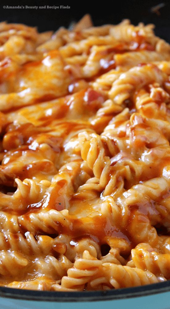 Barbecue sauce and cheese on pasta? Yep, and it's delicious! One skillet is all you need for this BBQ Cheesy Chicken Pasta. Creamy with a hint of sweetness.