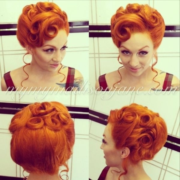 High updo with side curls and bangs curled to the sides. Lovely round shape for photographing.