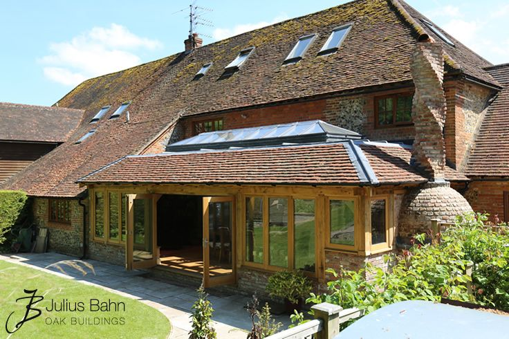 Tiled Oak Orangery with lantern and bi-folding doors #orangeries #oak #oakframed