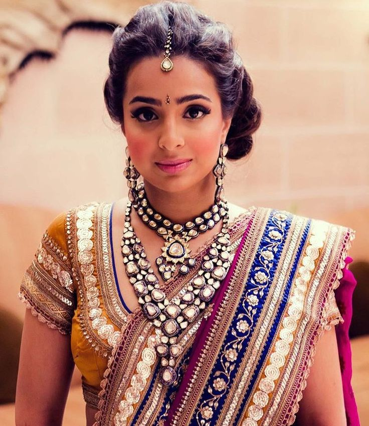 Indian Bride Sporting A Side Updo Wedding Hairstyle