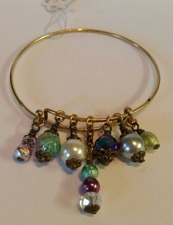 Check out this item in my Etsy shop https://www.etsy.com/au/listing/268594376/adjustable-charm-bangle