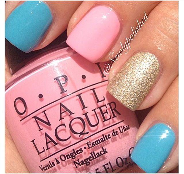 Pink and blue nail color with gold accent nail .Nails