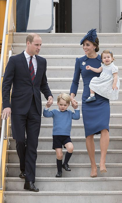 """As the family of four embarked on their first joint royal tour, they exited their plane slowly and carefully. Both parents held Prince George's hand as Prince William instructed him to """"watch the step."""" <br><br>Photo: © Christopher Morris/Hello! Canada"""