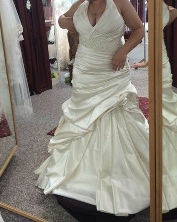 This halter style wedding gown has a slight empire waist. You can Have #plussizeweddingdresses like this recreated for you with any design change you need. For more info on custom #weddingdresses & inexpensive #replicaweddingdresses visit us on our main site at www.dariuscordell.com/