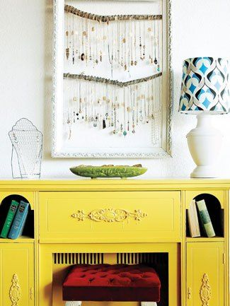 Use fabric strips stretched across an old frame to organize jewelry.