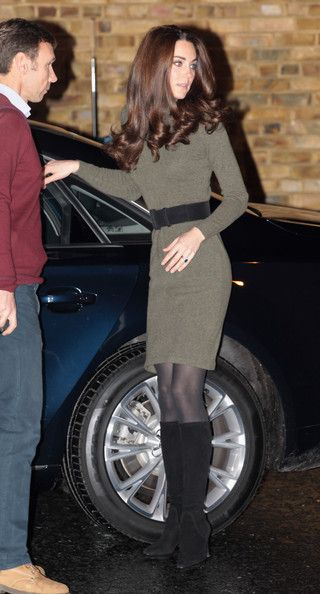 Kate Middleton prevented her belted sweater dress from being too modest, by accessorizing it with a pair of flirty knee high boots.