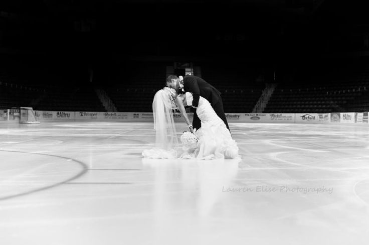 This photographer of their wedding took them to their Ice-skating rink to catch this photo because the groom is a hockey player. thought this was totally cool!!! Loved it!! What a great idea! :D